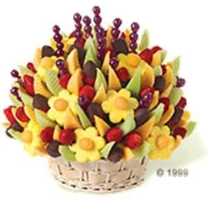 Edible Arrangements, Orange — Edible Arrangements® has a fresh fruit bouquet to make any occasion special - from weddings, receptions, birthdays, anniversaries and congratulations to business events and client gifts & favors. Our bouquets, gourmet dipped fruit boxes and party favors are made fresh with premium fruit arranged in a variety of stunning displays. Customers can visit one of our 913 stores worldwide, order online or via phone. Each bouquet can be complemented with chocolate dipped fruit including dipped strawberries, dipped pineapple daisies, dipped banana slices, dipped Granny Smith apple wedges and more! Make every occasion special with Edible Arrangements®.