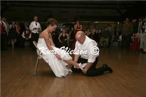 Kurt Nielsen Photography - Detroit, Detroit — Rick removing the garter from Cira's leg.