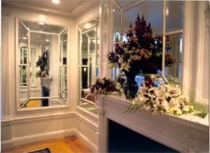 Mirrored Parlor, The Endicott Estate, Dedham — Gorgeous flower arrangements decorating the mantle in the Mirrored Parlor.