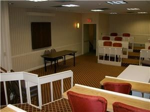 Lorain, RAMADA Elyria, Elyria — The Lorain Room offers an excellent atmosphere for training classes, orientations or any meeting where a classroom setting is needed.  Ampitheater seating accommodating up to 50 guests and a presenter's area at the front.