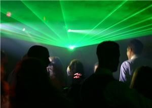 Lasers by LaserJockey- New York, Pleasantville — Laser fan sweeps over the crowd. Just one of many laser effects our LaserJockeys can mix at you event. We compliment any music or type of event. Call us for a free consultation.