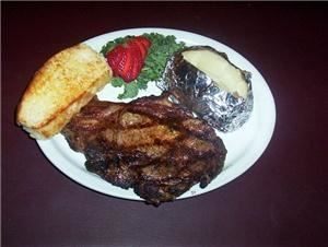 the MarketPlace Catering - Mitchell, Mitchell — One of our Steak House favoriets ~ Grilled Ribeye with baked potato and Grilled French Bread.