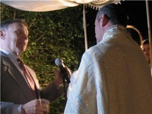 Rabbi Seidman, Irvine — Rabbi Seidman officiating at a beautiful, outdoor, evening wedding.