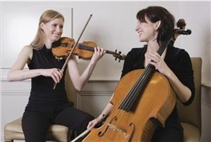 Duo d'Amore-string duos, trios and quartets, Toronto — Duo d'Amore musicians Pam Hinman, violinist and Lydia Munchinsky, cellist. Used with kind permission of Amazing Canadian Fashion Magazine. See Duo d'Amore in issue VI!