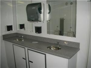 Event Restroom Rentals, Bartlett — Mobile restrooms with corian* counters air-conditioning and heat.
