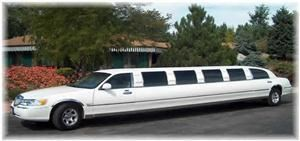 Elegant Image Limousine Service, Elyria — This is a classic super stretched white limousine, perfect for an elegant wedding.  Wrap-around seating available for 13 with a fireplace, fiberoptic lighting and more.