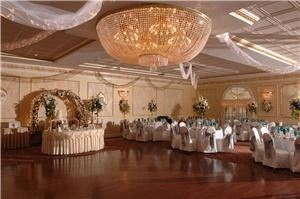 Vanity Fare Caterers, Lakewood — Ballroom surrounded by Italian crystal chandeliers, gold leaf molding and silk centerpieces.
