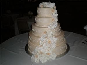 opulent cakes, Colleyville — Ivory buttercream cake with cascading handmade gumpaste roses and orchids.