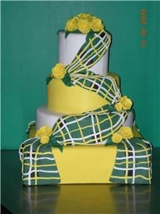 Lovely Little Cake Shop, Mesa — I have noticed that there is not too many wedding cakes with an Irish theme. I have created a four tier cake both square and round shapes. I have an Irish Tartan (kilt)draped across all layers of cake with yellow roses as accents.