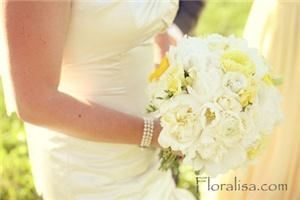 Floralisa - Napa, Napa — Clean and crisp peonies, rannunculas, garden roses and freesia make up this soft and fluffy bridal bouquet.