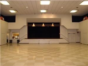 Holly Auditorium, Holly Community Center, Union City — A view of the stage and banquet floor.  The full kitchen is visible to the left of the stage.