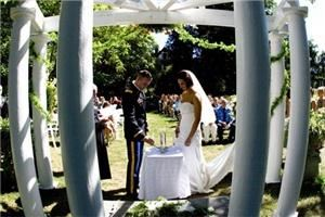 Wedding Ceremony Sites, Sonnenberg Gardens & Mansion State Historic Park, Canandaigua — Seen from behind during this 2007 ceremony, is the classical, white Pergola where most couples choose to host their wedding ceremonies. Image courtesy Mark Bernreuther Photography.