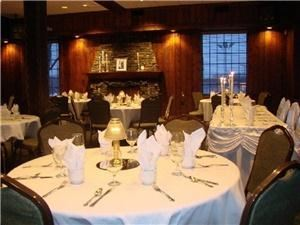 19th Hole, St Andrews Golf & Country Club, West Chicago — For the smaller weddings or banquets. The room features a cozy fireplace, rich wood paneled walls, pub bar and large windows on two sides.