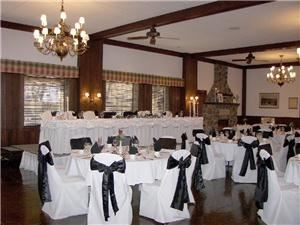 Trophy Room, St Andrews Golf & Country Club, West Chicago — For small - medium weddings and banquets. The room offers an overlook of our 32 acre wooded golf practice center, with chandelier lighting, cozy fireplace, decorated in rich wood tones. (minimum guarantee, 50 adults)