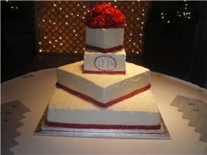 Sweet Persuasions LLC, Pickerington — Offset square buttercream wedding cake with red gumpaste roses.