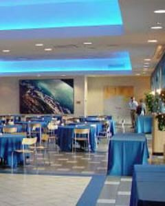 "Museum Cafe, Museum of Science, Boston, Boston — The Galaxy Café provides a truly ""space age"" atmosphere. Attendees will mingle underneath the soft glow of blue neon lights while they gaze out at the Charles River and Boston Skyline. The Galaxy Café is suitable for sit-down dinner for up to 250 guests or a reception with limited seating for 300 guests. Included amenities are on site parking for all guests, A Museum function coordinator, a Museum program, tables and chairs, CD access, podium and microphone. Full on site audiovisual services are available for rental as well. Our exclusive Caterer, Wolfgang Puck Catering is on site and ready to create a tailored menu and beverage service for you and your guests."