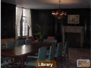 The Library, Scranton Cultural Center, Scranton — This quiet, elegant room is much as it was when first opened in 1930. A large fireplace set into the full wood paneled walls greets you as you enter from the tiled lobby