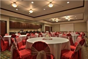 Bluebonnet Banquet Room, Best Western Plus Duncanville/Dallas, Duncanville — Banquet room with Red Satin Strip Chair Covers and White Linens.