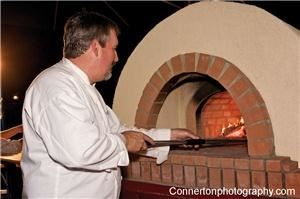 Bravo Wood Fired Pizza Catering, North Kingstown — An authentic Italian wood fired pizza oven makes the best pizza your guests have ever tasted. They can watch as pizza bakes in 2 minutes with the finest ingredients. Breakfast pizza and dessert pizza, antipasti, salads, gourmet cuisine in a casual and fun atmosphere.