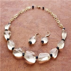 Judith Collins Jewelry, West Orange — Lemon quartz and sapphires on gold chain with matching earrings.
