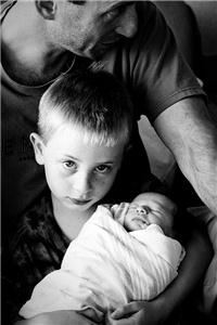 Richard Mallory Allnutt - Photography and Digital Imaging, Fairfax Station — Lila's first day. This is a photograph of a client's son holding his baby sister for the very first time. She was just a few hours old. It was a magical, wonderful experience being there for this moment, and it remains one of my most favorite images. I recently photographed baby Lila just after her first birthday as well...