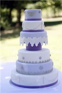 Buttercream Bakehouse, Greenville — 6 Tier lavendar, white and silver wedding cake.