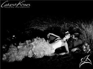 Cakes And Kisses Wedding Photography, Glendale — couple laying in grass in wedding clothes after the wedding. Burbank, CA