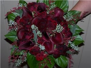 All Flowers and Charm Flower shop, New Hamburg — Rich Burgandy Calla Lilies with Black Magic Sweetheart Roses create an elegant Bride's Bouquet.
