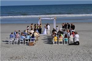 Outer Banks Wedding Service - Nags Head, Nags Head — HOLIDAY ENGAGEMENT SEASON SPECIAL! Receive up to an $800 Cash Discount Off 2011 Wedding Packages Booked with Full Payment! Officiant only services, officiant & photography combination packages, elopement packages, and ceremony decor rentals also available. 
