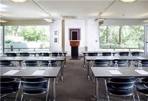 Hines Seminar Room, Aspen Meadows Resort, Aspen — A versatile, private meeting space with terrace access.