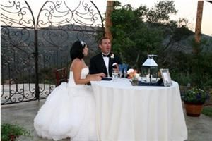 "Entire Facility, Secluded Garden Estate, Pala — Our Bride and Groom are Featured at a Sweeetheart Table on the Sweetheart patio. Beautiful Antique ""Heart"" Gates behind them frame the  Sunset view of  unobstructed Mountain Ridges."