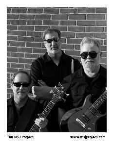 The MSJ Project, Falls Church — The MSJ Project is a three-piece band that plays a mix of original music and classic rock tunes. Our original tunes range in style from rockabilly and blues to new wave and light jazz. Our cover tunes include classics by The Beatles, Chuck Berry, Cream, Creedence Clearwater Revival, Jimi Hendrix, The Rolling Stones, Roy Orbison, Santana, and Van Morrison. The MSJ Project plays in clubs, corporate events, private parties, block parties, and any other occasion where classic rock is welcome. The MSJ Project consists of Kelly Markin on bass guitar, keyboards, and vocals, Al Schwartz on drums, and Lee Gordon Jones on guitar and vocals.
