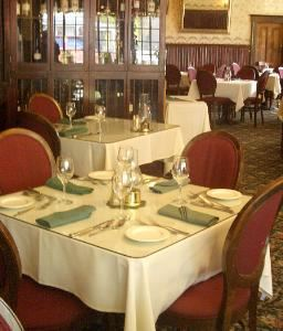 1859 Historic National Hotel, Jamestown — Our elegant Victorian dining area is perfect for receptions, wedding dinners and weddings. In warm weather couples often choose to have the ceremony on our vine covered patio and move inside for the reception dining and socializing. Along with our above average dining fare, we offer a full service bar. Nine romantic historic rooms in on second floor.