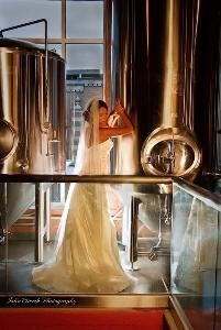 John Wirick Photography, Allentown — Bride shot between the tanks at Allentown Brew Works.