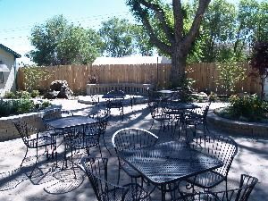 Dee's Bakery Courtyard Cafe and Venue, Reno — Full patio with water feature and fire pit. Three large light trees and lighted patio leading into a full dinning room.