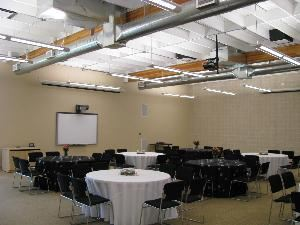 "The Event Room, OneREALTOR®Center, Tyler — The Event Room can seat up to  130 with 60"" rounds or up to 160 theatre style.  It offers a SMART board, 2 DLP Projectors with drop down screens, free wifi, adjustable lighting, incredible sound system and a full catering kitchen."