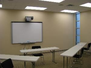 "The Training Room, OneREALTOR®Center, Tyler — The Training room is private and high tech.  Free Wi-Fi, SMART board and training tables can offer your business event everything you are looking for.  Seating can be theatre style (50); classroom style (35) or  60"" rounds for your next small banquet (32)."