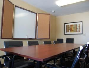 Meeting Room, Days Inn Bridgeview, Bridgeview — The Days Inn of  Bridgeview offers a relaxed or business atmosphere in our meeting room for up to 12 people. The room is perfect for a board meeting, small social gathering, a private interview, or retreats. The room comes complete with a wax board for your presentation at no additional charge. Call our Guest Service Representatives availability and rates.