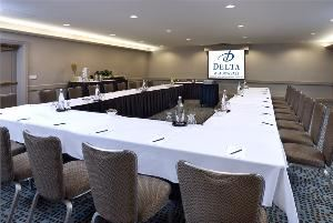 Patio Studio 1, Delta Meadowvale Hotel & Conference Centre, Mississauga — Patio Studio 1 is located on the ground level of the hotel. It features natural light through floor to ceiling windows and double doors that open onto a patio perfect for meeting attendees to enjoy fresh air.