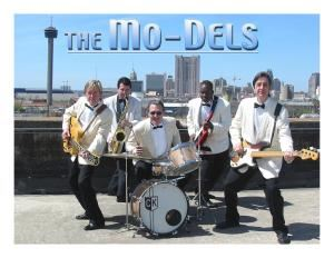 The Mo-Dels, San Antonio — The Mo-Dels are one of the most successful dance bands in  Texas. They have performed at  conventions, college and high school events, debuts, weddings, bar mitzvahs, night clubs, festivals and  shared the stage with groups like U2, Stevie Ray Vaughn, Cheap Trick, The Oak Ridge Boys and The Fabulous Thunderbirds. The Mo-Dels play a variety of music ranging from Big Band Swing to 50's and 60's Rockn'Roll, from 70's Disco music to Techno Rock of the 80's and 90's and many of everyones favorite music today. Their music catalog also includes  a wide selection of Country and Western music as well as many Latin flavored songs.