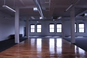 Space with a Soul, Boston — 7th floor loft, empty (with stage in background).