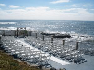 Inn at Sunset Cliffs, San Diego — The traditional ceremony setup on our waterfront terrace directly touching the Pacific Ocean. Long isle for a dramatic touch...