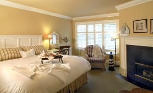 "Harbour House Hotel, Niagara on the Lake — Our Premium Guestrooms all have King Size beds with down duvets and featherbeds, gas fireplaces, 40"" Flat Screen TV's, DVD Players, Clock Radio with iPod dock and in room coffee makers."