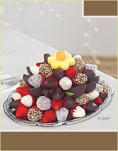 Edible Arrangements, Feasterville Trevose — A perfect addition to any table display, The Sweet Indulgence Platter® is a delicious combination of our favorite gourmet chocolate dipped fruit. Includes chocolate dipped strawberries in semi-sweet chocolate, chocolate with coconut, chocolate with almonds and white chocolate, chocolate dipped apple wedges, chocolate dipped oranges, fresh strawberries and our signature pineapple daisy, all presented on our own keepsake platter that you'll treasure even after all the fruit is gone!
