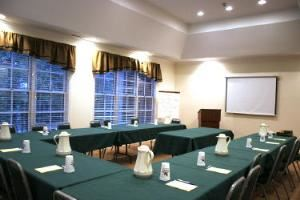 Conference room, Burnt Pine Weddings and Special Events, Newborn — Conference room seats 30 classroom style, and 40 lecture style.  AV equipment is available and the room is Wi-Fi friendly. Food & beverage catered to your specifications.