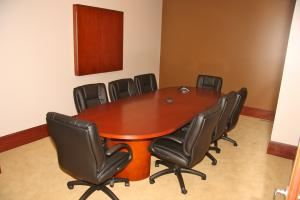 Lakeville Executive Suites, Lakeville — Two furnished conference rooms available for rent with executive leather chairs, white boards and flat screen tv for presentations.