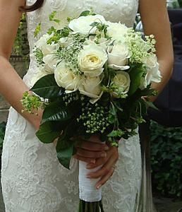 Duffy's Flowers and Plants, Solon — white roses with bluepleurum and other greens
