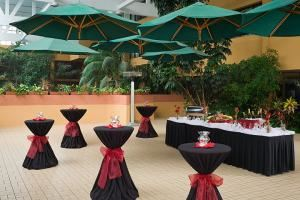 Garden Atrium, Hotel Eleganté Conference & Event Center, Colorado Springs — Hotel Eleganté offers numerous options for receptions to include our premier venue The Garden Atrium. This enclosed solarium offers the best of both worlds! Your guests are protected from the elements while still getting to enjoy the natural sunshine and tropical setting of this glassed enclosure.