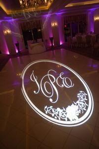 Golden Reception Presentation, BeDazzled Entertainment - Disc Jockeys, Dallas — ADD ON...Standard and Animated Gobos-Now you can have you name, date, logo, and/or monogram projected onto the dance floor with an animated background. It will stand out more as it moves with animated hearts, rings, musical notes, and more. The animated gobos are just $350. The standard gobo, as pictured here, starts at $150.