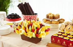 "Edible Arrangements Suwanee, Suwanee — The Edible Arrangements® Wedding Collection of custom fruit bouquets are the perfect marriage of taste and style. Whether you're looking for centerpieces for wedding tables, wedding favor ideas, or even a sweet alternative to a traditional wedding cake, our Wedding Arrangements are the freshest way to say ""I Do."" Plus, our in-store Fruit Experts bring their think big ideas, event-planning perspective and nuptial know-how to the wedding table. We'll help you turn your Dream Wedding into a reality with our wedding centerpiece ideas, unique wedding favors, beautiful (and delicious) wedding decorations and more. Our sweet, handmade table centerpieces are designed to be as beautiful as flowers in bloom, and as tasty as a decadent dessert."